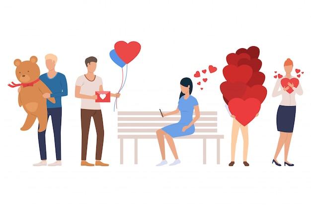 Set di incontri. uomini e donne che tengono il cuore