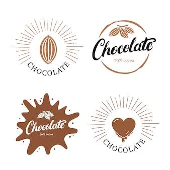 Set di lettere scritte a mano al cioccolato con fave di cacao.