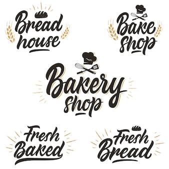 Set di loghi scritti a mano, distintivi per una panetteria o panetteria.