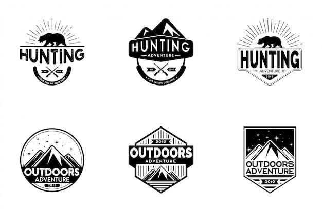 Set di logo distintivo classico di caccia e avventura