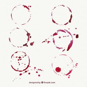 Set di macchie di vino con spruzzi