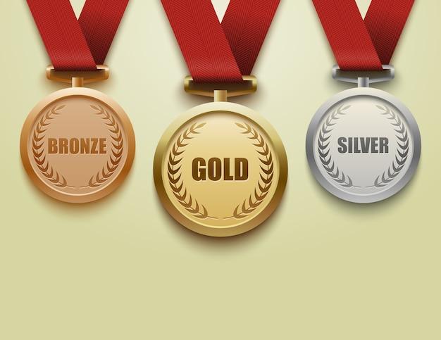 Set di medaglie d'oro, argento e bronzo con nastro rosso