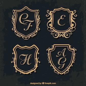 Set di monogrammi di scudo d'oro
