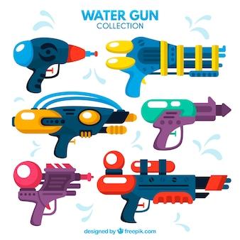 Set di pistole ad acqua in plastica in stile piatto