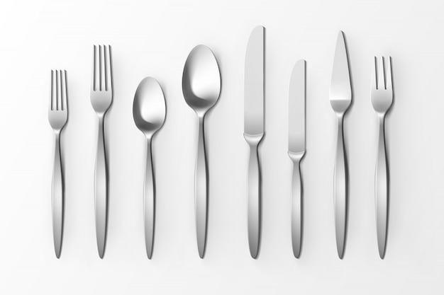 Set di posate vettoriale di cucchiai e coltelli di forchette d'argento