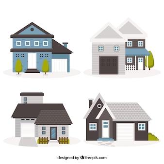 Set di quattro case d'epoca nel design piatto