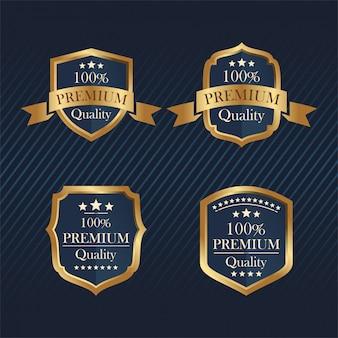 Set di quattro distintivi d'oro. distintivo premium. elemento vettoriale
