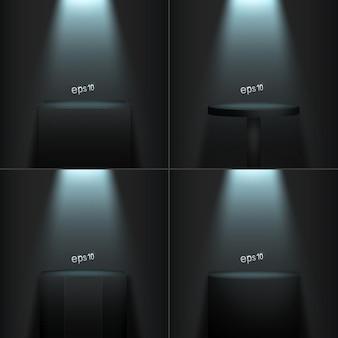 Set di quattro podi realistici su una stanza buia.