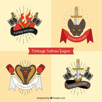 Set di quattro tatuaggi di logos