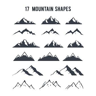 Set di sagome di montagna disegnata a mano.