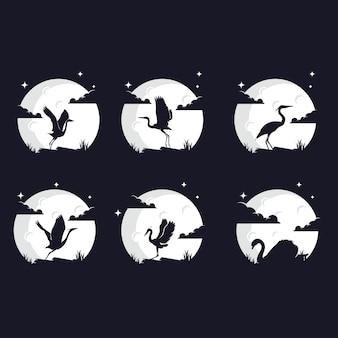 Set di sagome di uccelli contro la luna