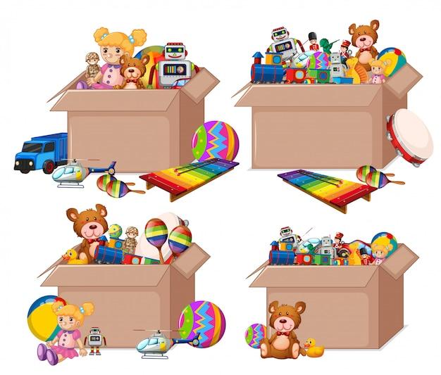 Set di scatole piene di giocattoli su bianco