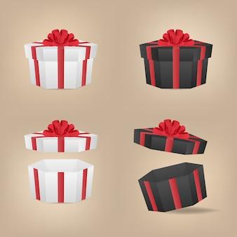 Set di scatole regalo decorativo bianco e nero con fiocco rosso.