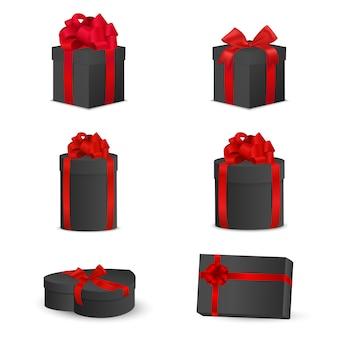 Set di scatole regalo nero con fiocchi rossi e nastri.