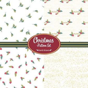 Set di schemi natalizi. scarabocchi disegnati a mano. motivi floreali