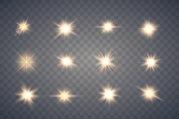Set di scintille d'oro isolato. stelle incandescente di vettore