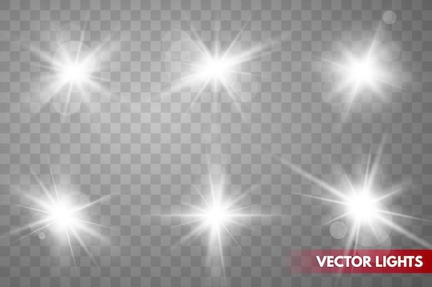 Set di scintille isolate. stelle incandescente di vettore. riflessi di lenti