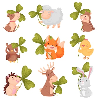 Set di simpatici animali con trifoglio