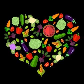 Set di verdure a forma di cuore sul nero
