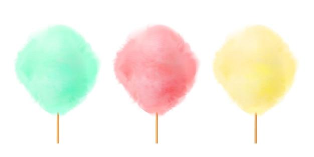 Set di zucchero filato. caramelle di cotone gialle rosa verdi realistiche sui bastoni di legno.