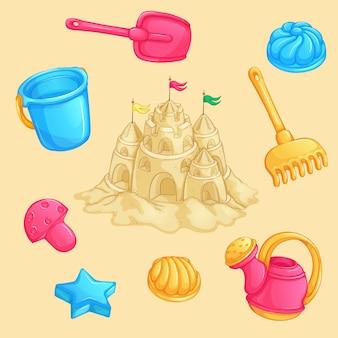 Set estivo di giocattoli di sabbia e un castello di sabbia con torri e bandiere.