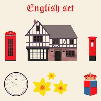 Set inglese con cottage, telefono, orologio, giunchiglie, cassetta delle lettere e braccio con corona.