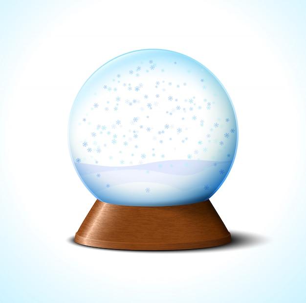 Sfera di neve di vetro di natale con fiocchi di neve