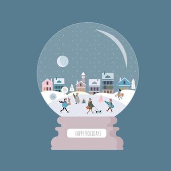 Sfera magica di natale con la città e la gente di inverno