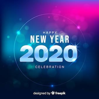 Sfocato nuovo anno 2020 sul gradiente blu