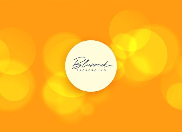 Sfondo arancione con luci bokeh sfocato