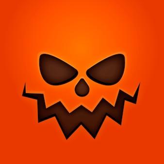 Sfondo arancione con volto di zucca di halloween