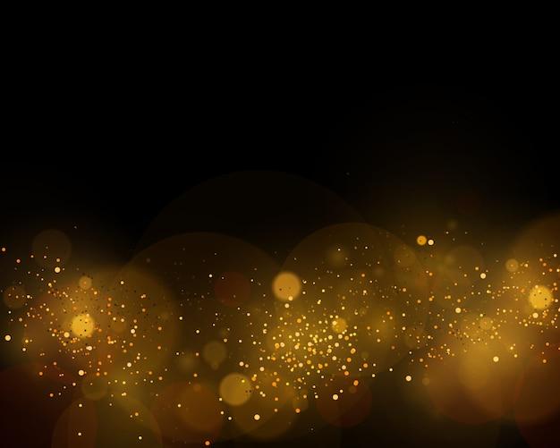 Sfondo astratto con effetto bokeh oro. particelle di polvere.