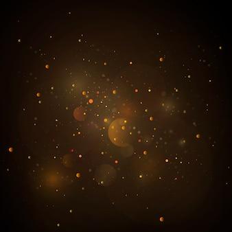 Sfondo astratto con effetto bokeh oro, particelle di polvere.