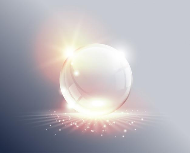Sfondo astratto. sfera di vetro trasparente su alba. palla con luci soffuse