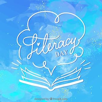 Sfondo blu acquerello di alfabetizzazione giorno con libro aperto