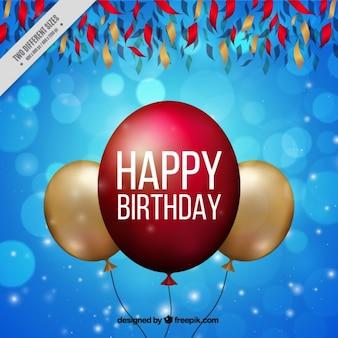 Sfondo blu bokeh con palloncini compleanno