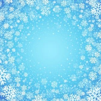 Sfondo blu con fiocchi di neve, biglietto di auguri
