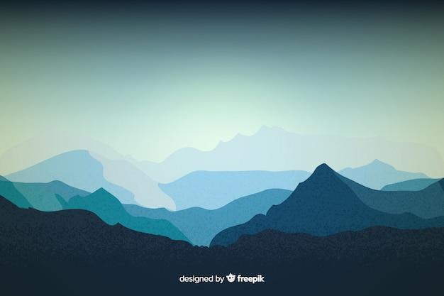 Sfondo blu con vista sulle montagne