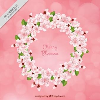 Sfondo bokeh con decorativo corona di fiori di ciliegio