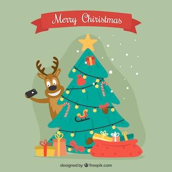 Sfondo decorativo con albero di natale e bella renna
