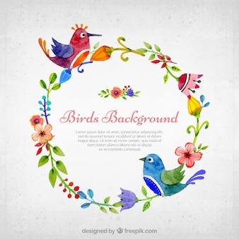 Sfondo di belle uccelli acquerelli su corona floreale