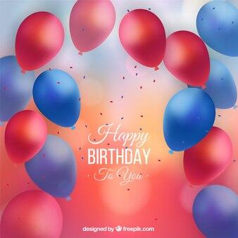Sfondo di compleanno con palloncini unfocused realistici