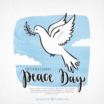 Sfondo di giorno della pace con colomba a mano disegnata