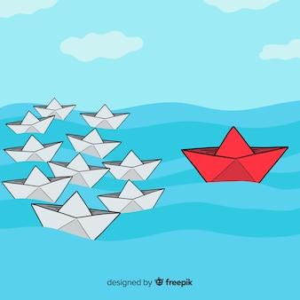Sfondo di leadership di barche di carta