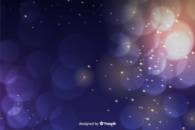Sfondo di lusso con particelle d'oro e blu bokeh