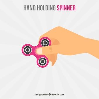 Sfondo di mano con spinner rosa
