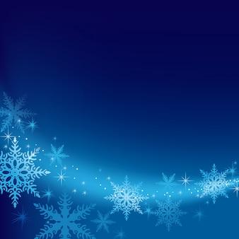 Sfondo di natale blu con fiocchi di neve