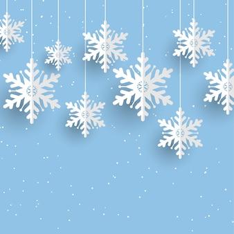 Sfondo di natale con appesi i fiocchi di neve