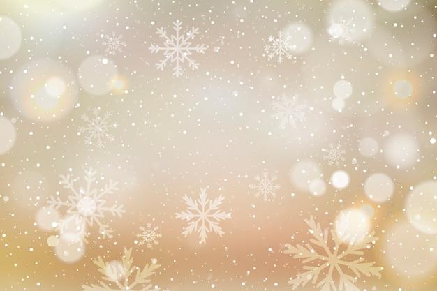 Sfondo di natale con bokeh e fiocchi di neve