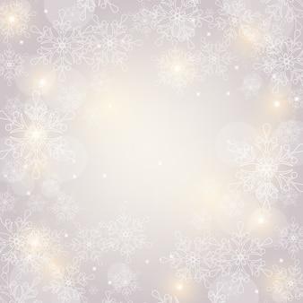 Sfondo di natale con fiocchi di neve e spazio per il testo